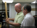 Tom C and Ted P work on building the latest, and learly last, benchwork on the layout by Brookfield Jct.